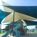commercial shade sails over a park