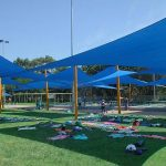 Multiple shade sails over swimming pools
