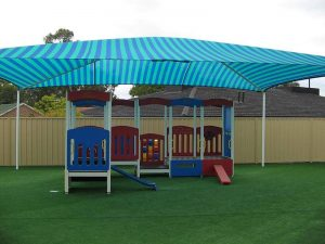 Span Shade Structure over Artificial Grass